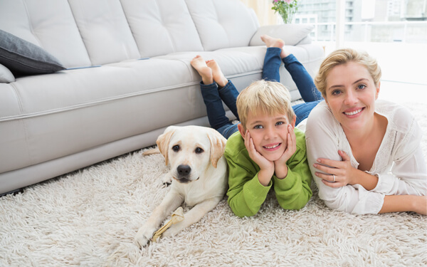 a picture of a mother and a child along with their dog showing content about their new room